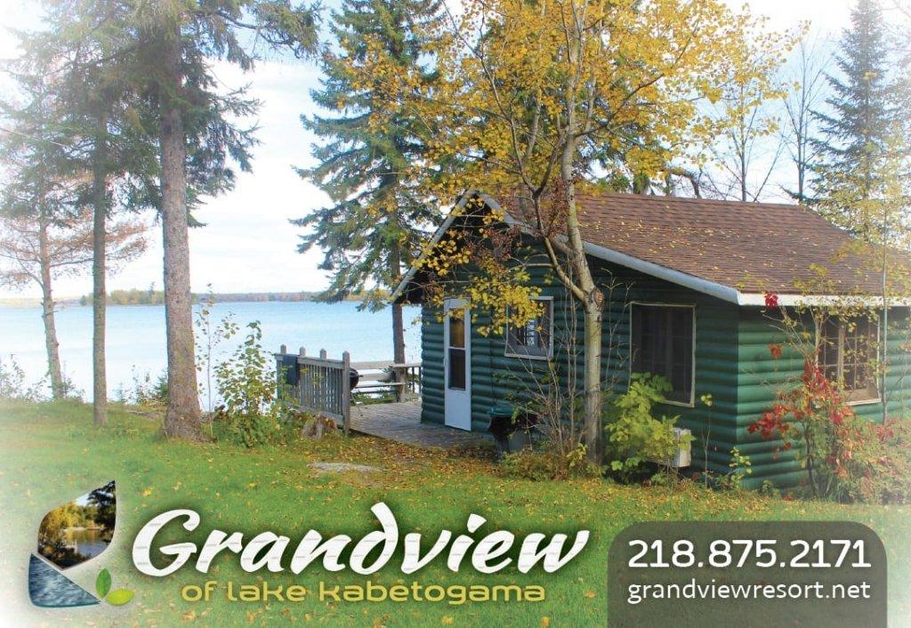Green cabin near lake.
