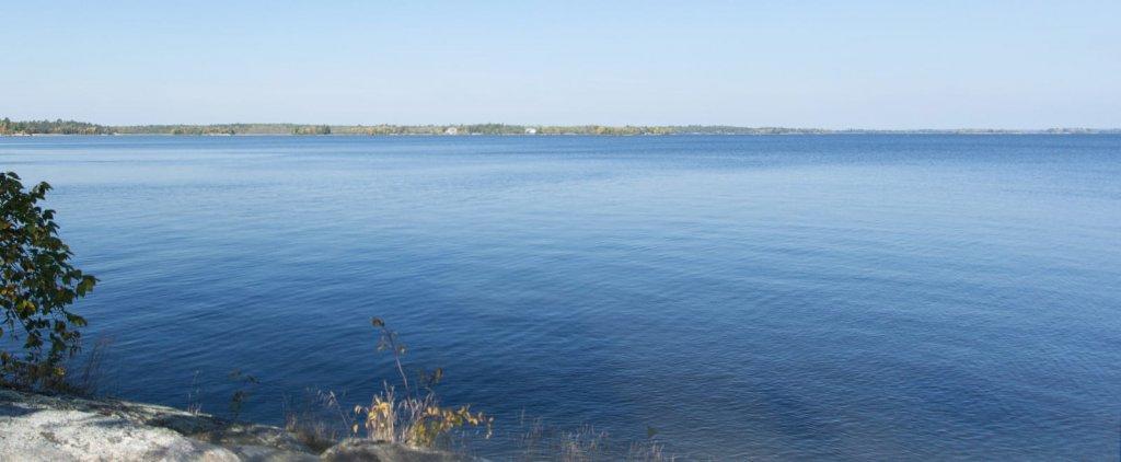Calm lake on sunny day.