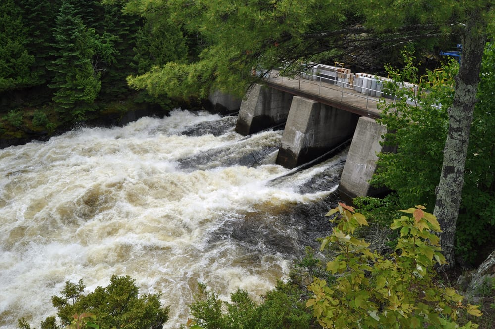 Man made dam with rapidly flowing water.