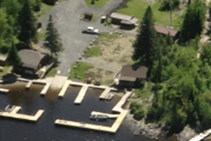Aerial view of resort and docks near lake.